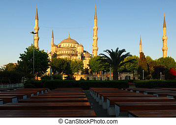 Blue Mosque at sunrise, perspective rows of benches in...