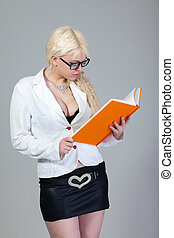 beautiful blonde student with a book