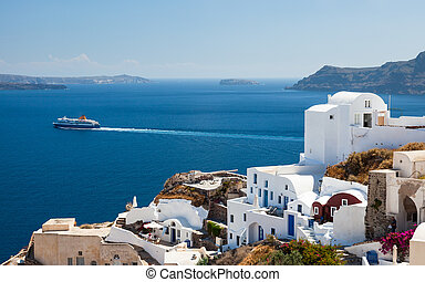 Oia Santorini Greece Europe - Ship passing Oia on the Island...