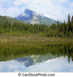Rundle mountain and its reflection - Rundle mountain and its...