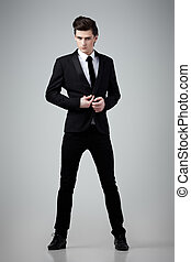 Black tie - Handsome young man in a classic black suit on...