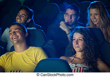 People in Cinema - People watching movie in cinema Selected...