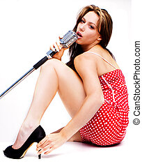sexy singer - sexy women in dotty red dress with microphone