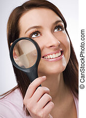 Loupe - Young business woman with loupe close up shoot