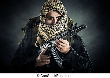 Terrorist with AK-47. Selected focus on eyes