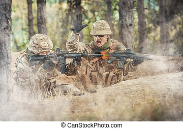 Two british soldiers in a fight Selected focus on soldier on...