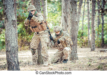 Two british soldiers in a fight. Selected focus on soldier...