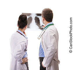 A medical team of doctors with X-ray, man and woman,...