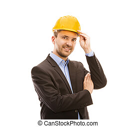 Young engineer with yellow helmet is isolated on white...