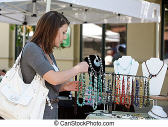 Girl buying jewelry - A teenage girl looking at gemstone...