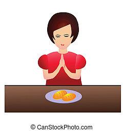 Woman praying during dinner