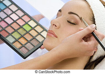 Beautiful Make Up - A beautiful young woman having the final...