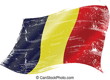 Belgian flag grunge - flag of Belgium in the wind with a...