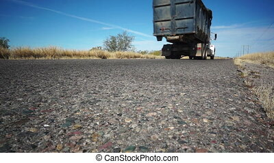 Highway Road Truck Going - Low angle shot of an arid, semi...
