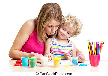 Mother and kid girl play together