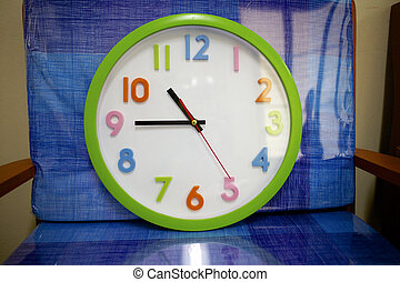 Colorful and round toy clock isolated