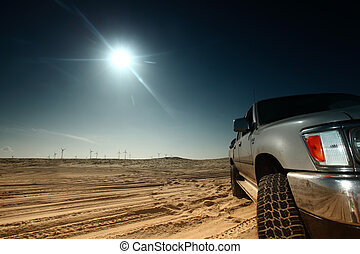 desert truck - truck in desert sand and blue sky