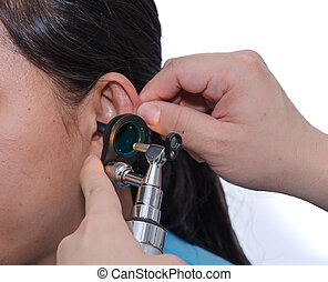 ENT physician checking patients ear using otoscope with an...