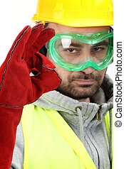 safety - Worker with protective gear showing OK sign