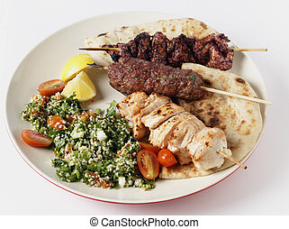 Mideast style barbecue meal - Various barbecued kebabs -...