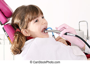little girl with open mouth during drilling treatment at the...