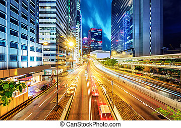 China Shenzhen night - light trails on the street at dusk in...