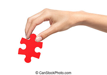 Red puzzle with woman hand isolated on white