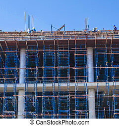 construction people makeing buildings