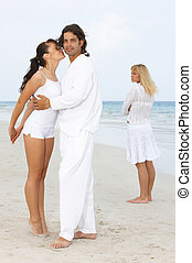 Envy - Romantic young couple spending time at the beach