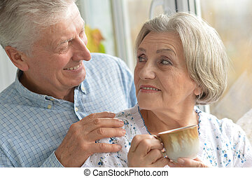 Elderly couple drinking tea - Happy elderly couple drinking...