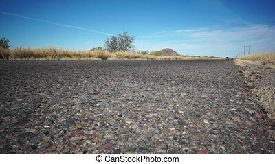 Highway Road Truck Coming - Low angle shot of an arid, semi...