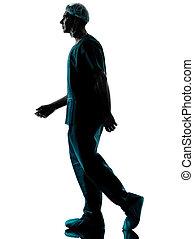 doctor surgeon man walking silhouette