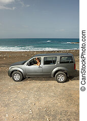 Girl and Car - Woman and her 4wd car at Fuerteventuras beach...