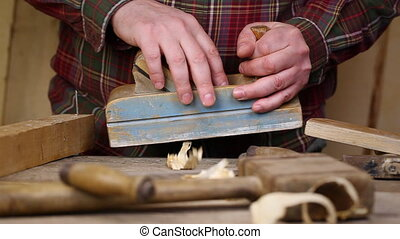 Carpenter with a planer
