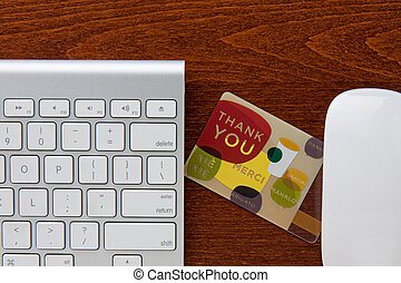 Thank You - Thank you gift card in between keyboard and...