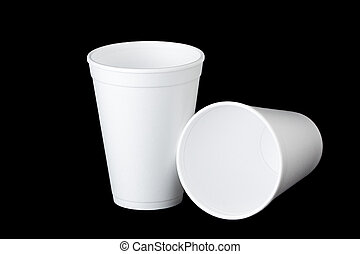 two styrofoam cups on black - Two empty styrofoam cups on...