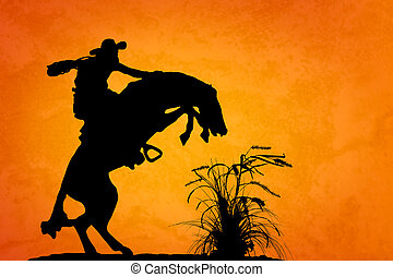 Spooked Stallion - Silhouette of cowboy reigning bucking...