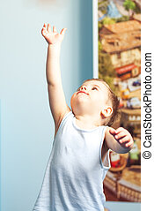 Little boy toddler reaching up at home - Little boy toddler...