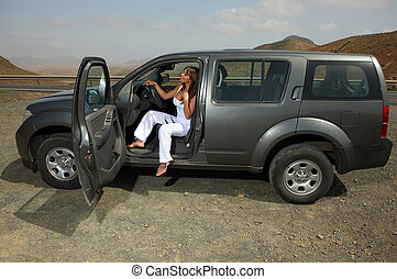 Girl and Car - Woman and her 4wd car at Fuerteventuras...
