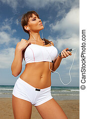 Fitness on beach - Young beautiful woman during fitness on...