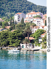 White Cabin Cruiser Docked in Croatia - Beautiful port in...