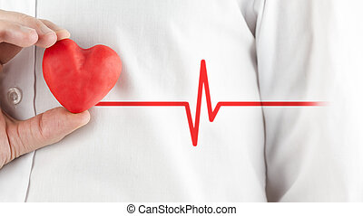 Healthy heart and good health - Man in a white shirt holding...