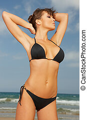 Girl in Black Bikini - 20-25 years woman wearing black...