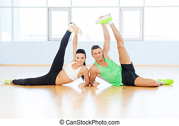 Healthy and fresh. Sporty couple exercising at the fitness gym