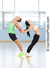 Love. Fitness couple forming a heart shape with their bodies