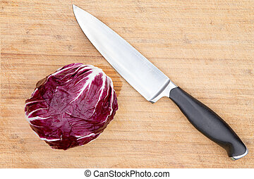 Red radicchio with a kitchen knife - Overhead view of a...