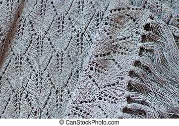 Detail of woven handicraft knit grey sweater - closeup...