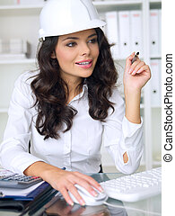 Business Woman - Beautiful female architect is working in...