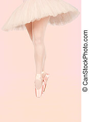 Ballet dancer standing on colourful floor while dancing in...