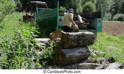 tired man log trailer - Tired worker man load trailer with...